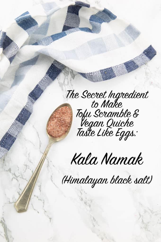 "a spoon with Kala Namak on a marble counter top with the writing ""the secret ingredient to make tofu scramble & vegan quiche taste like eggs: Kala Namak (Himalayan black salt)"