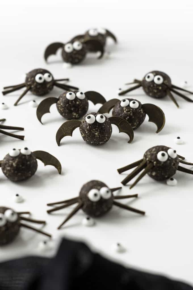 monster energy balls that look like little spiders on a white surface