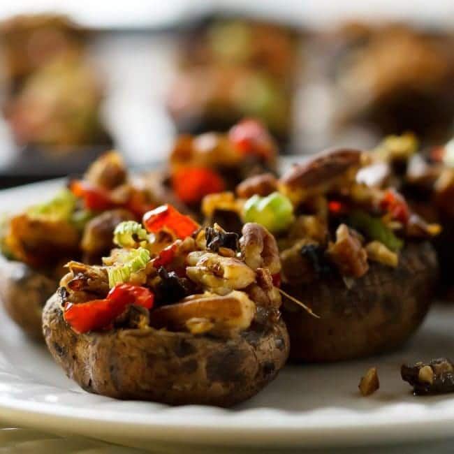 vegan stuffed portobello mushrooms on a white plate