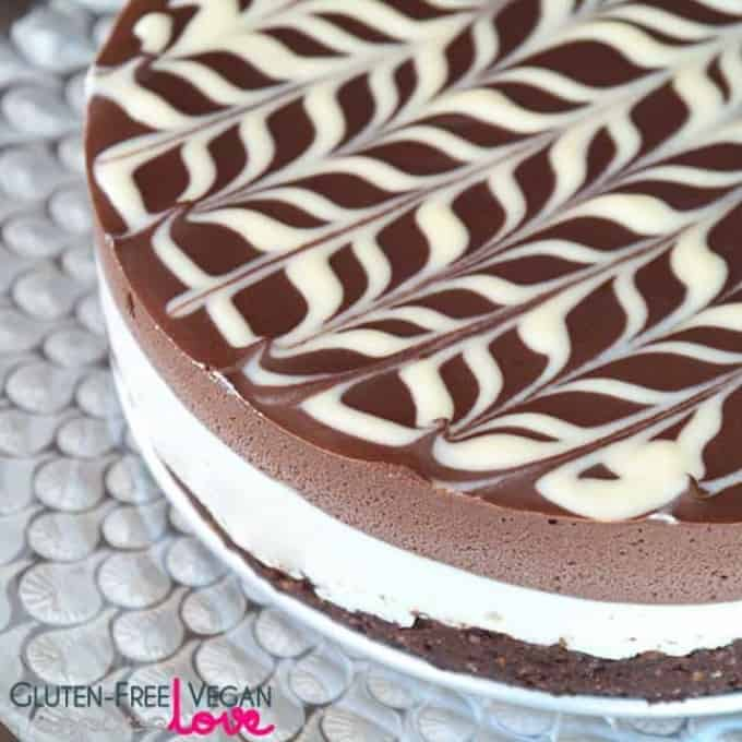a raw vegan black and white chocolate cake on a white plate