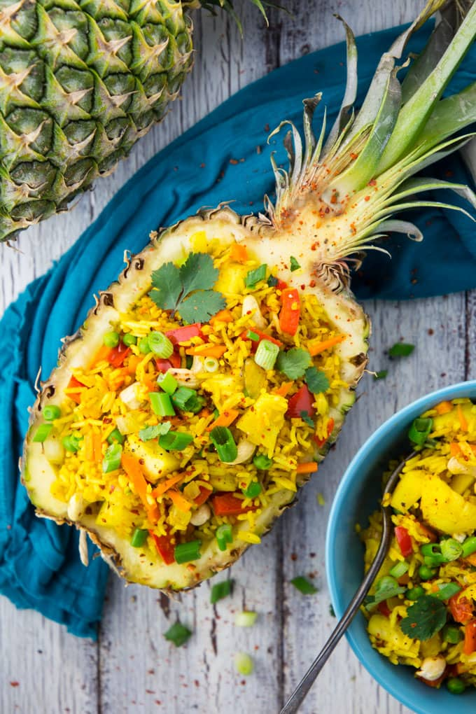 Thai Pineapple Fried Rice in a Pineapple Shell with Green Onions and Cilantro on Top