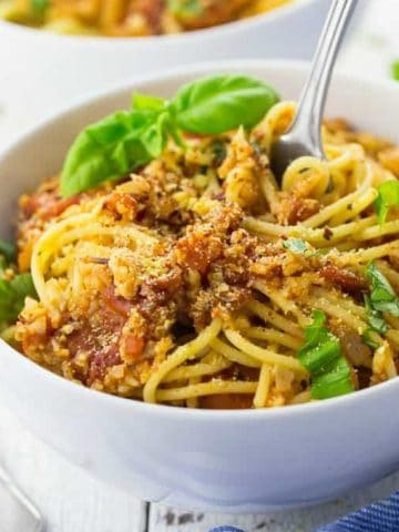 a white bowl with spaghetti with cauliflower bolognese
