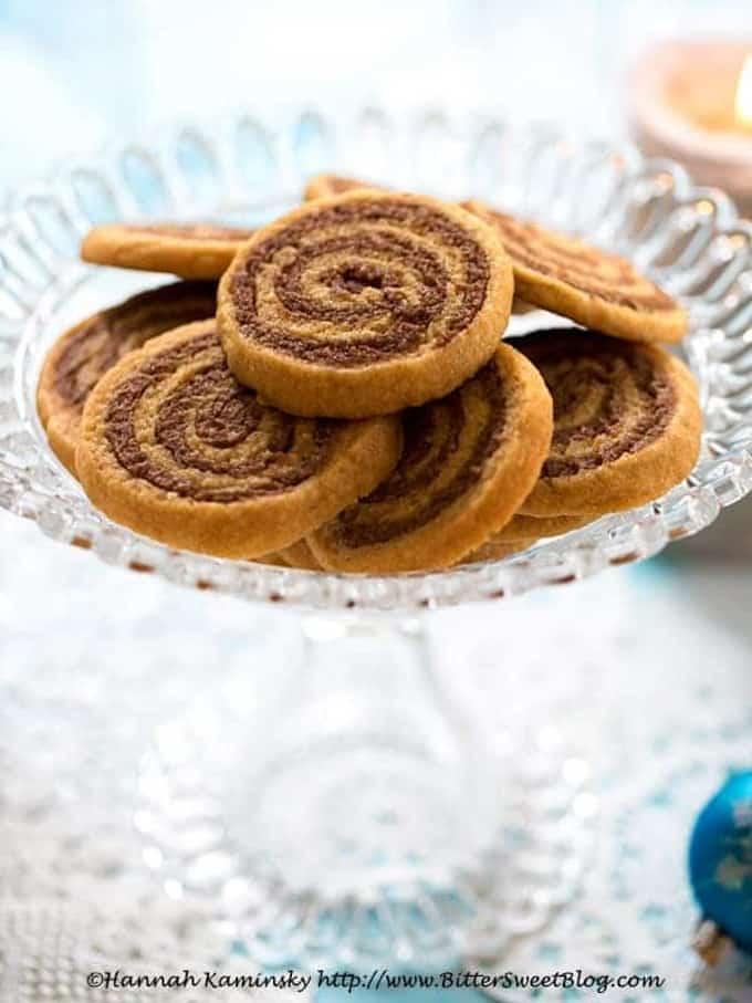 vegan cookie butter pinwheels on a glass cookie platter