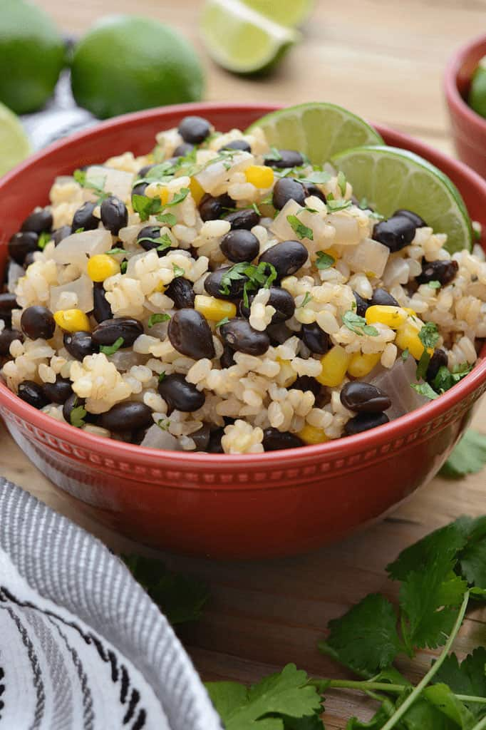 red bowl of black beans and lime rice