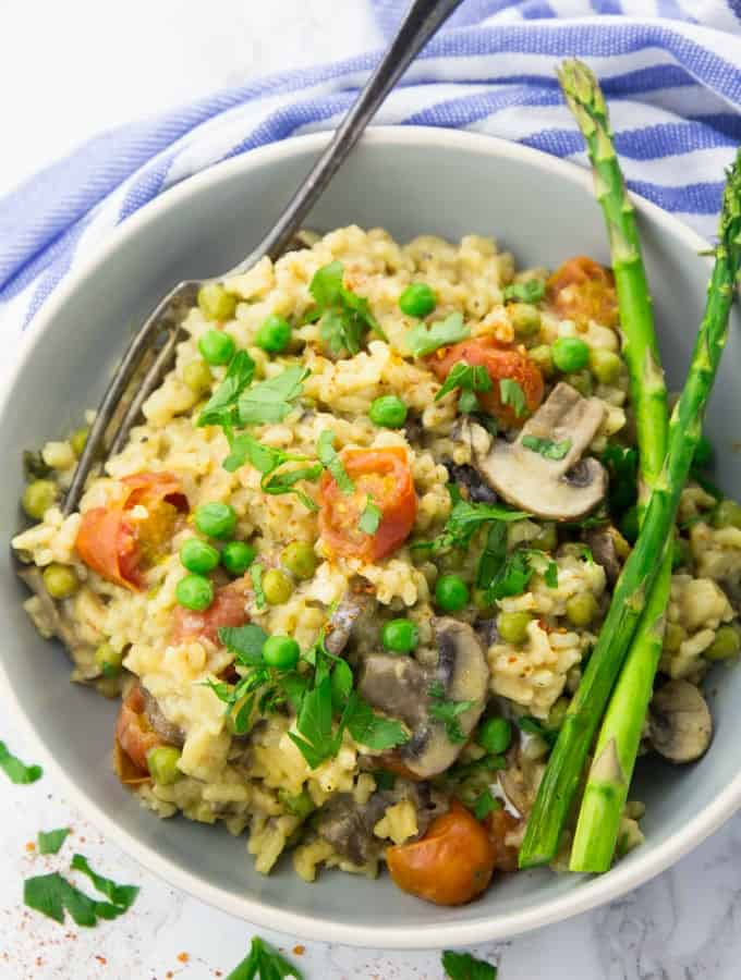 Instant Pot Risotto in a Bowl with Green Asparagus on the Side