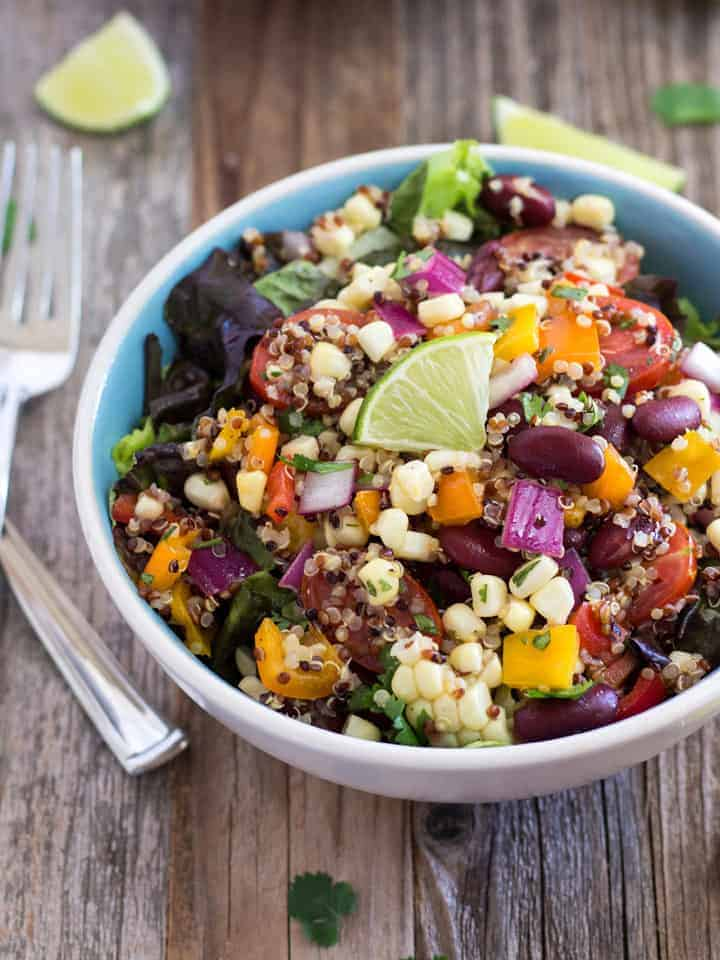 Summer Corn and Quinoa Veggie Salad with Lime Slices on Top