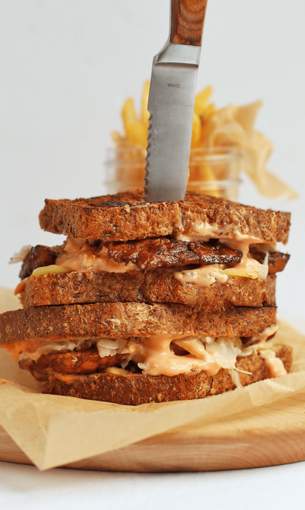 A Stack of Vegan Tempeh Reuben Sandwiches