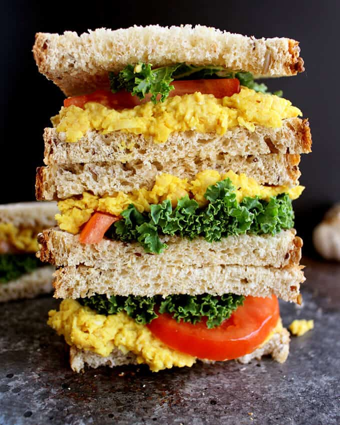 A Stack of Two Vegan Turmeric Chickpea Salad Sandwiches