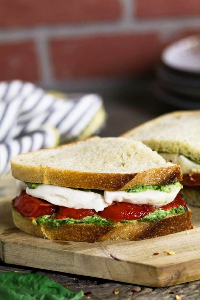 Roasted Red Pepper Sandwich with Vegan Mozzarella on a Wooden Board