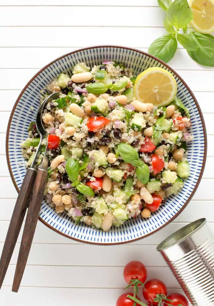 Vegan Quinoa Summer Salad in a Bowl with a Pair of Salad Servers