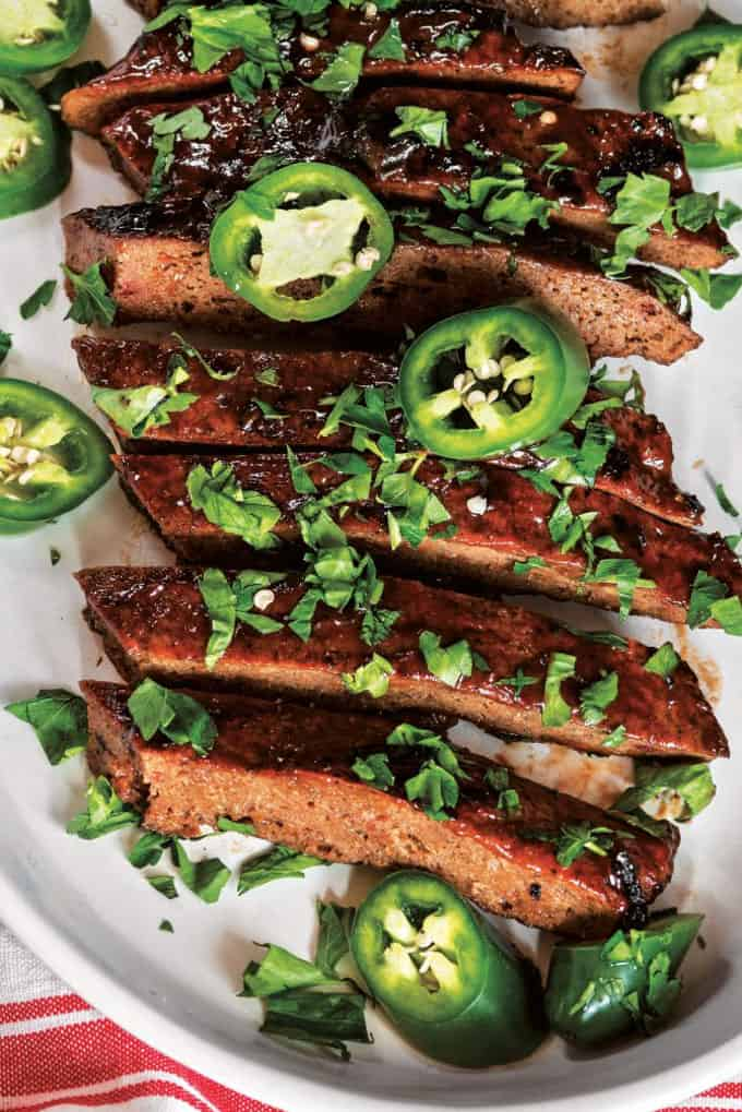 Vegan Seitan Ribs on a White Plate with Minced Cilantro on Top