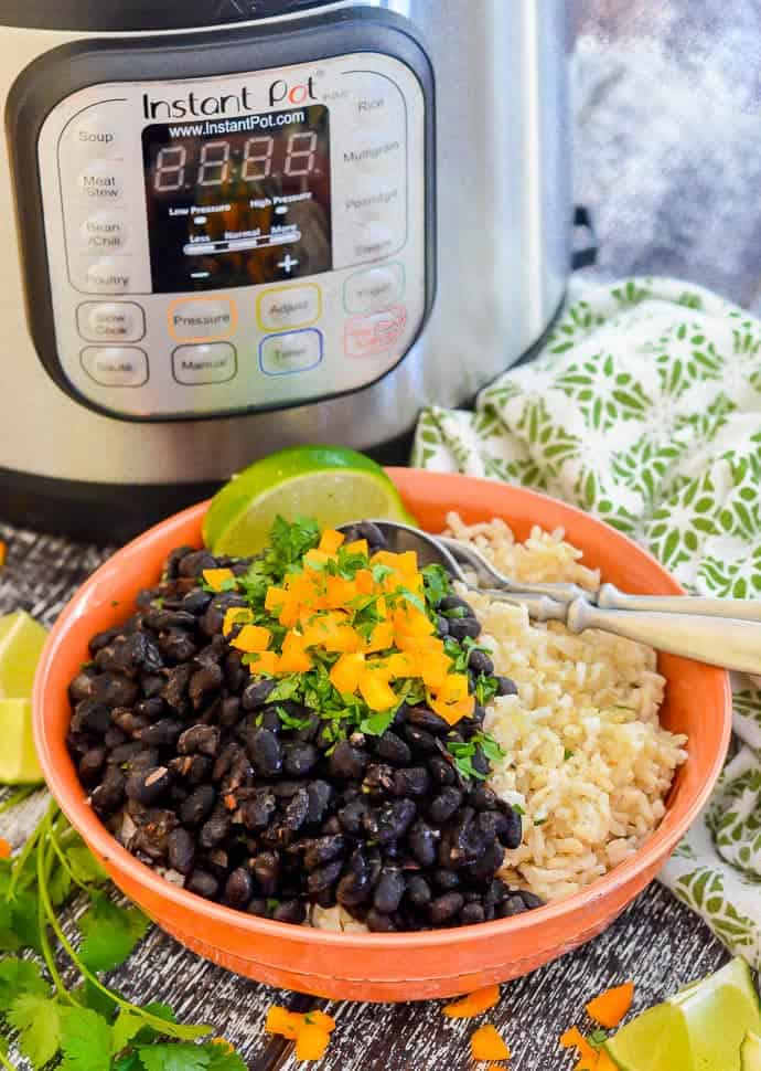 Vegan Seasoned Black Beans in a Bowl with Instant Pot in the Back