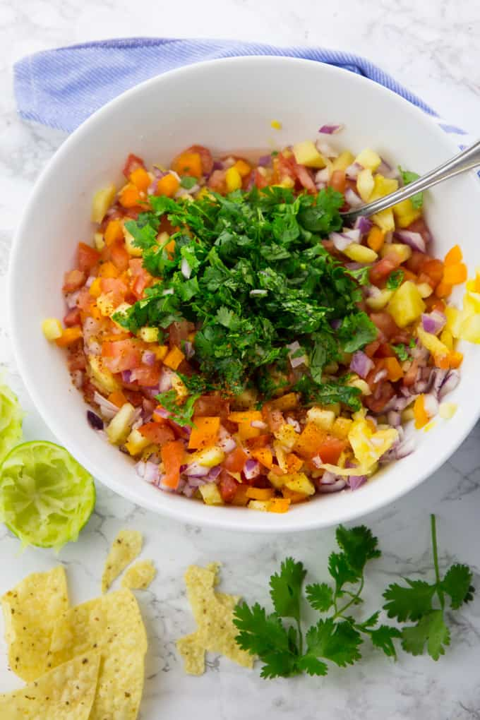 Pineapple Salsa in a Bowl with Chopped Cilantro on Top