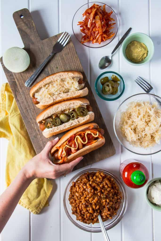 All American Hot Dogs on a Wooden Board