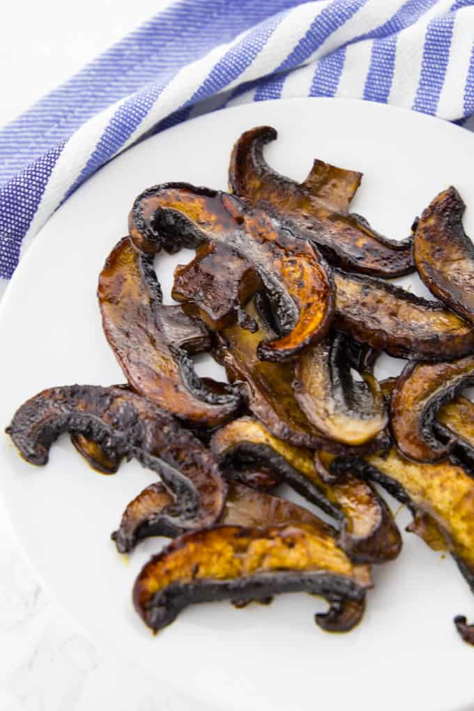 Vegan bacon made of portobello mushrooms on a white plate