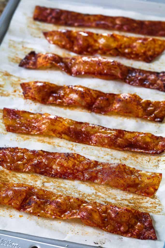 vegan bacon stripes made with rice paper on a baking sheet