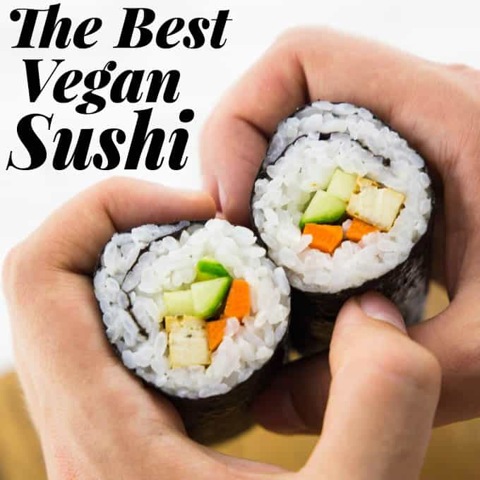 "a hand holding two sushi rolls with the a text overlay saying ""the best vegan sushi"""