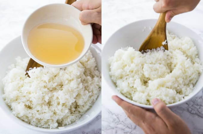 the rice vinegar and sugar mixture is added to the sushi rice and stirred with a wooden spoon
