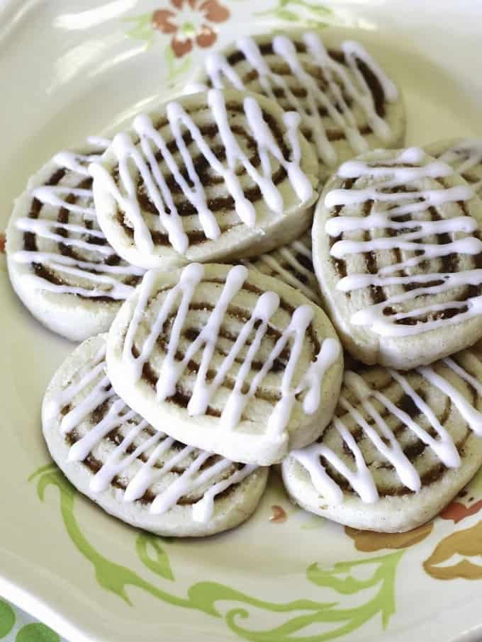 Gluten-Free Cinnamon Roll Sugar Cookies on a white plate with flowers