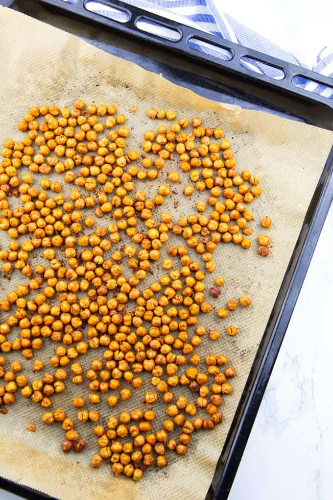Roasted Chickpeas on a baking sheet lined with parchment paper after baking