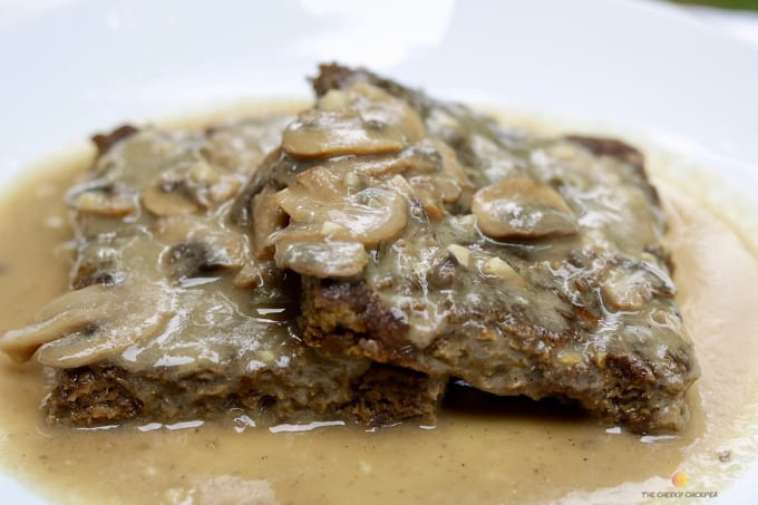 two vegan Salsbury steak with vegan gravy on a white plate