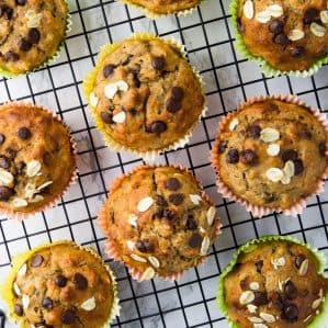 vegan banana muffins with chocolate chips on a cooling rack on a marble counter top