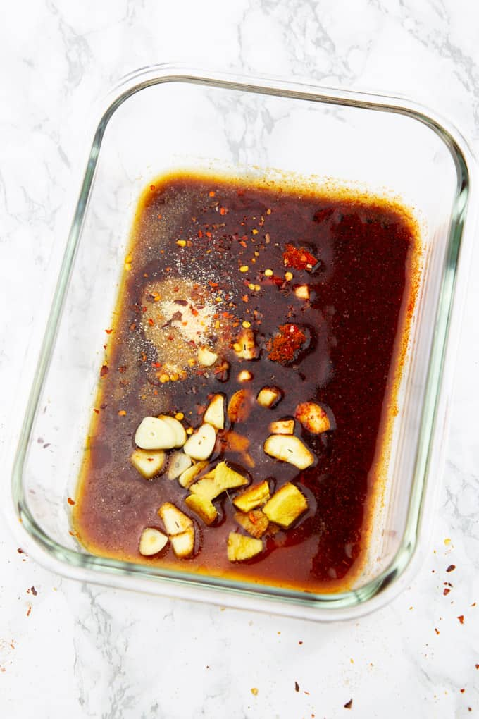 Tofu Marinade in a glass bowl on a marble countertop