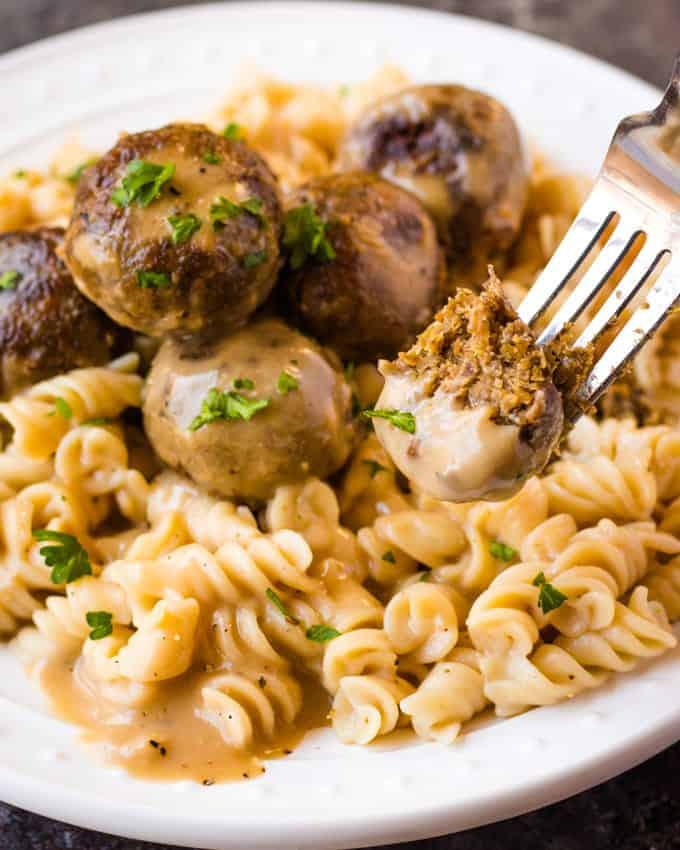 Vegan Swedish Meatballs with rotini pasta and vegan gravy on a white plate