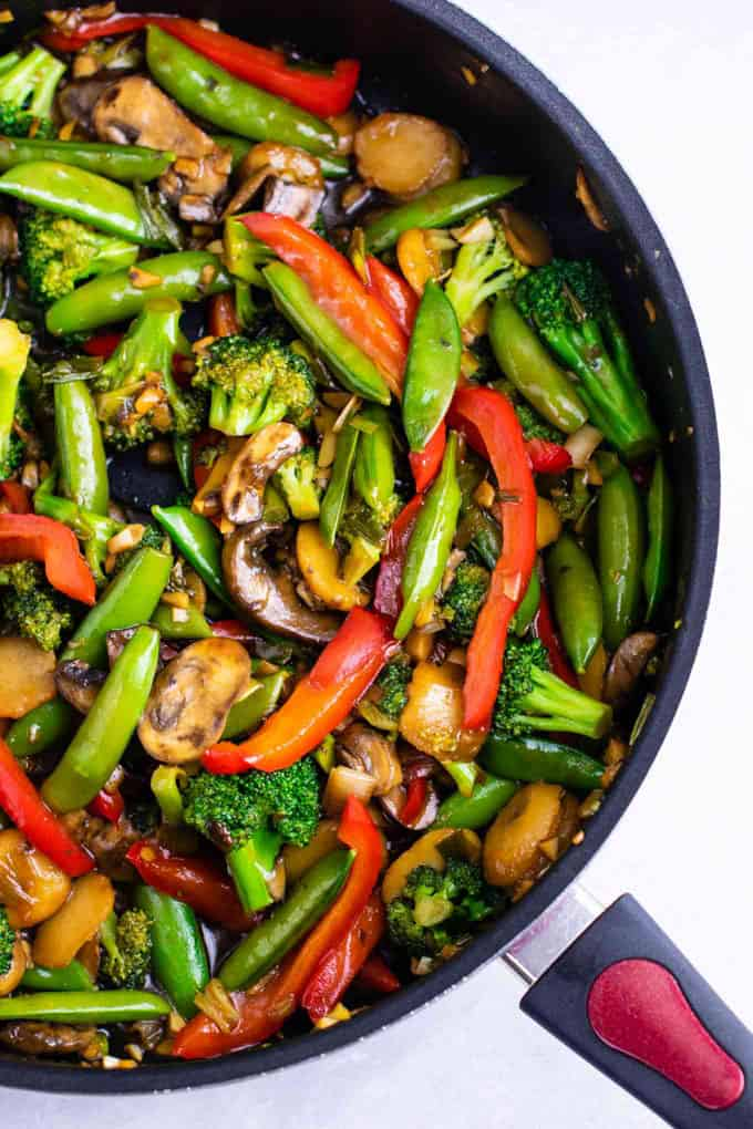 Stir Fry Vegetables in a black pan on a white countertop