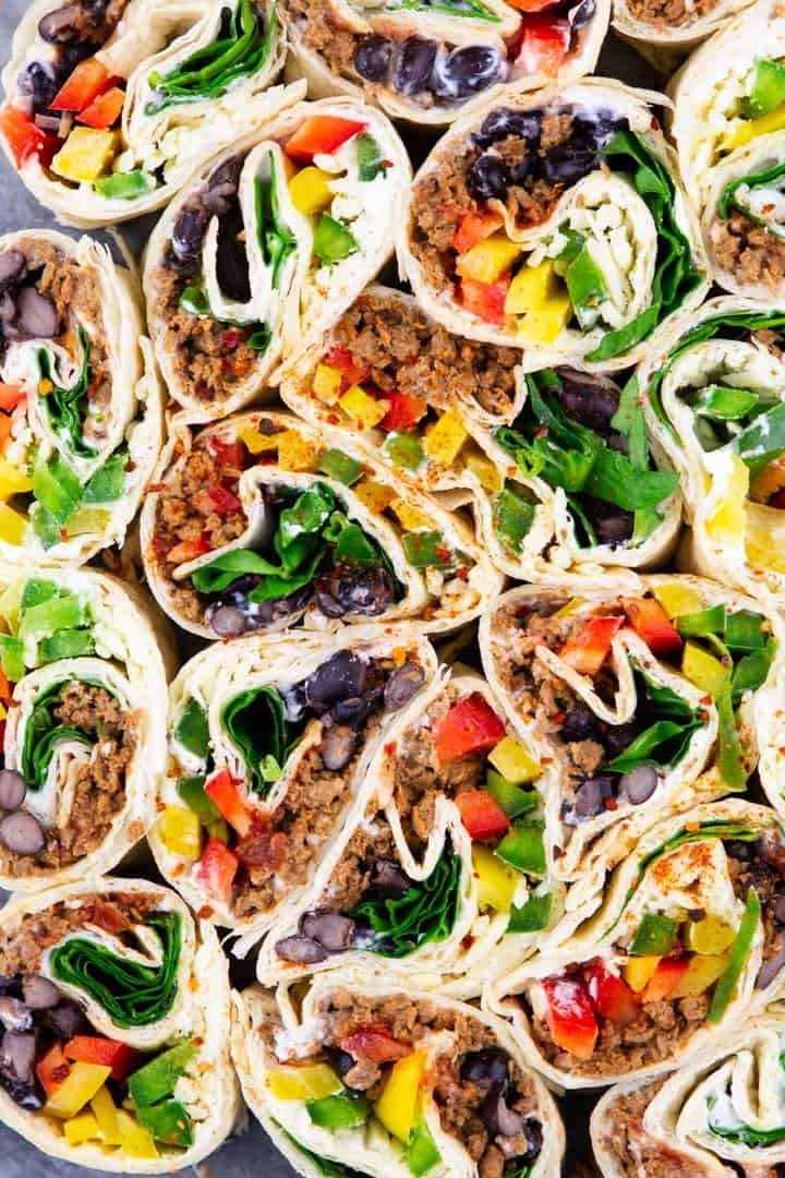 a close-up photo of Mexican pinwheels with black beans and bell peppers