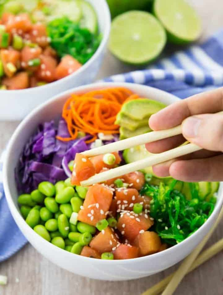 Vegan Poke Bowl with Watermelon with a hand holding chop sticks