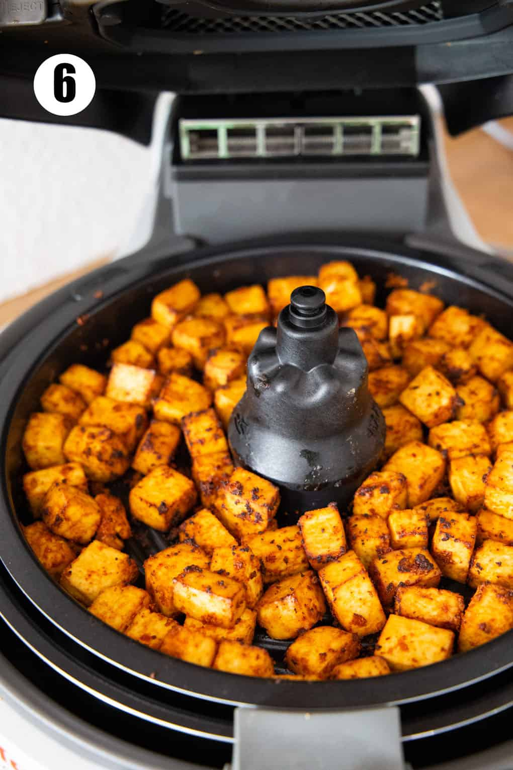 crispy tofu cubes in an air fryer