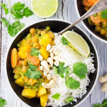 A bowl with chickpea curry and rice on the side