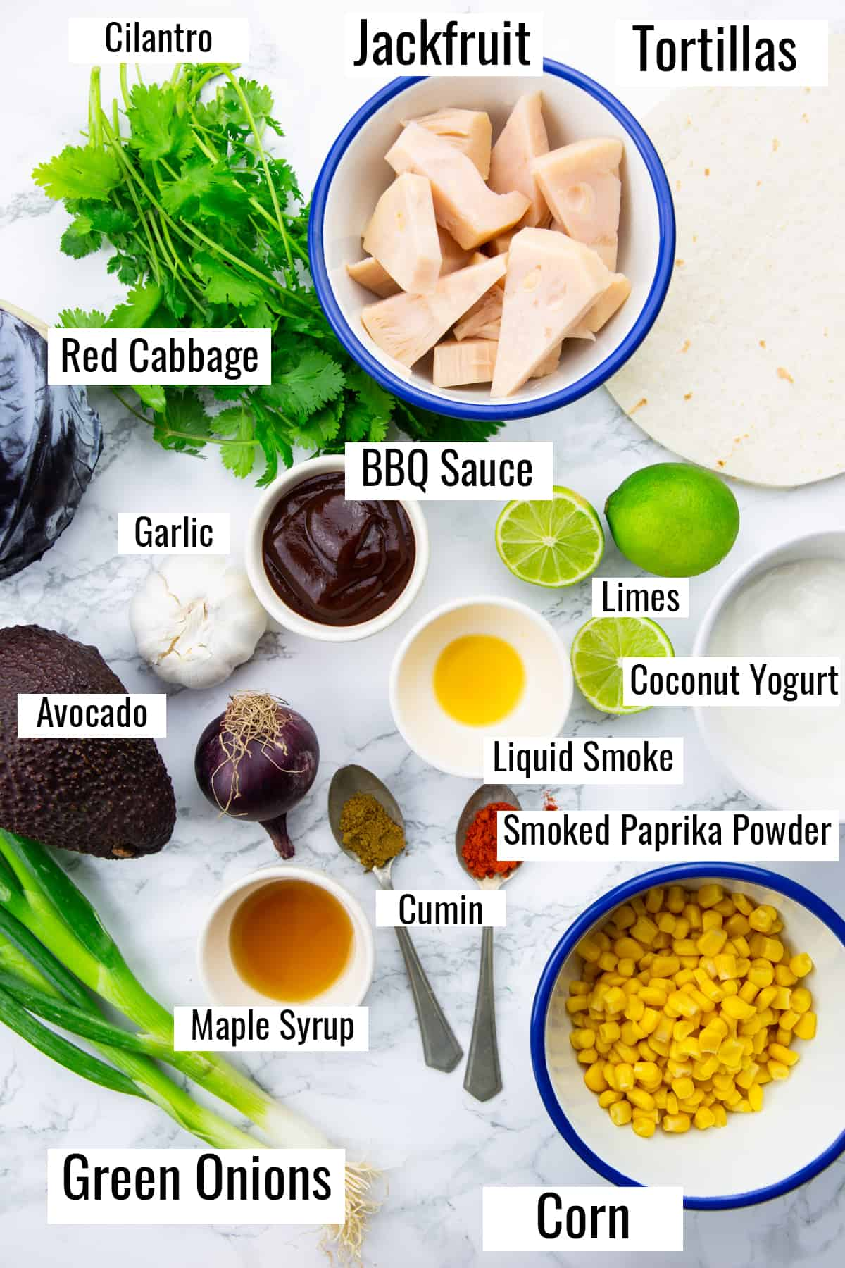ingredients that go into this recipe on a marble countertop with labels