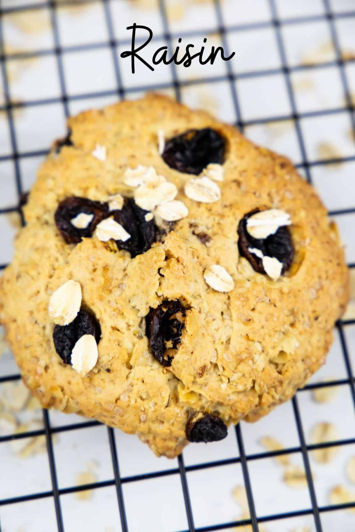 an oatmeal cookie with raisins on a cooling rack