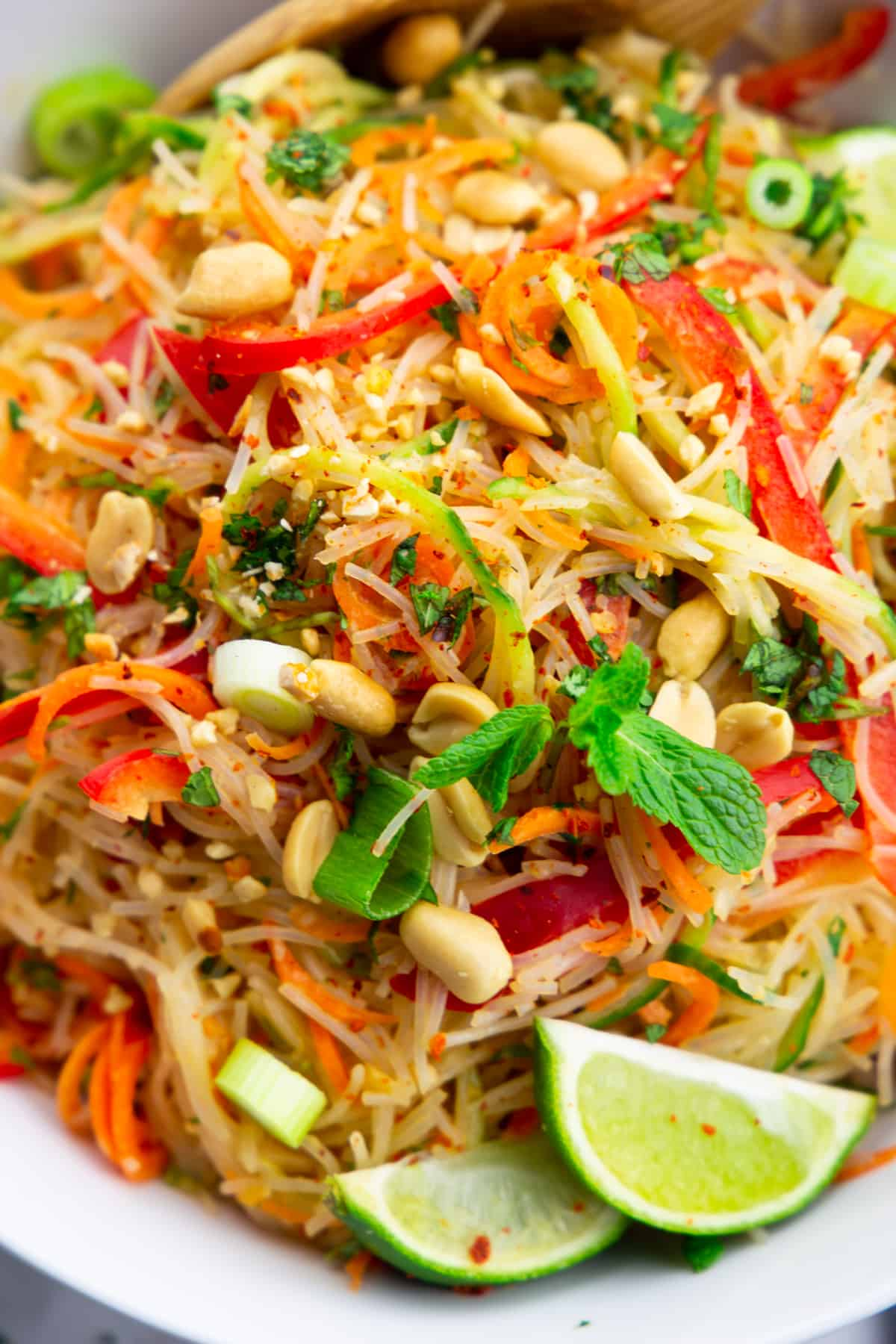 close-up photo of a glass noodle salad with cucumber, carrot, and bell pepper