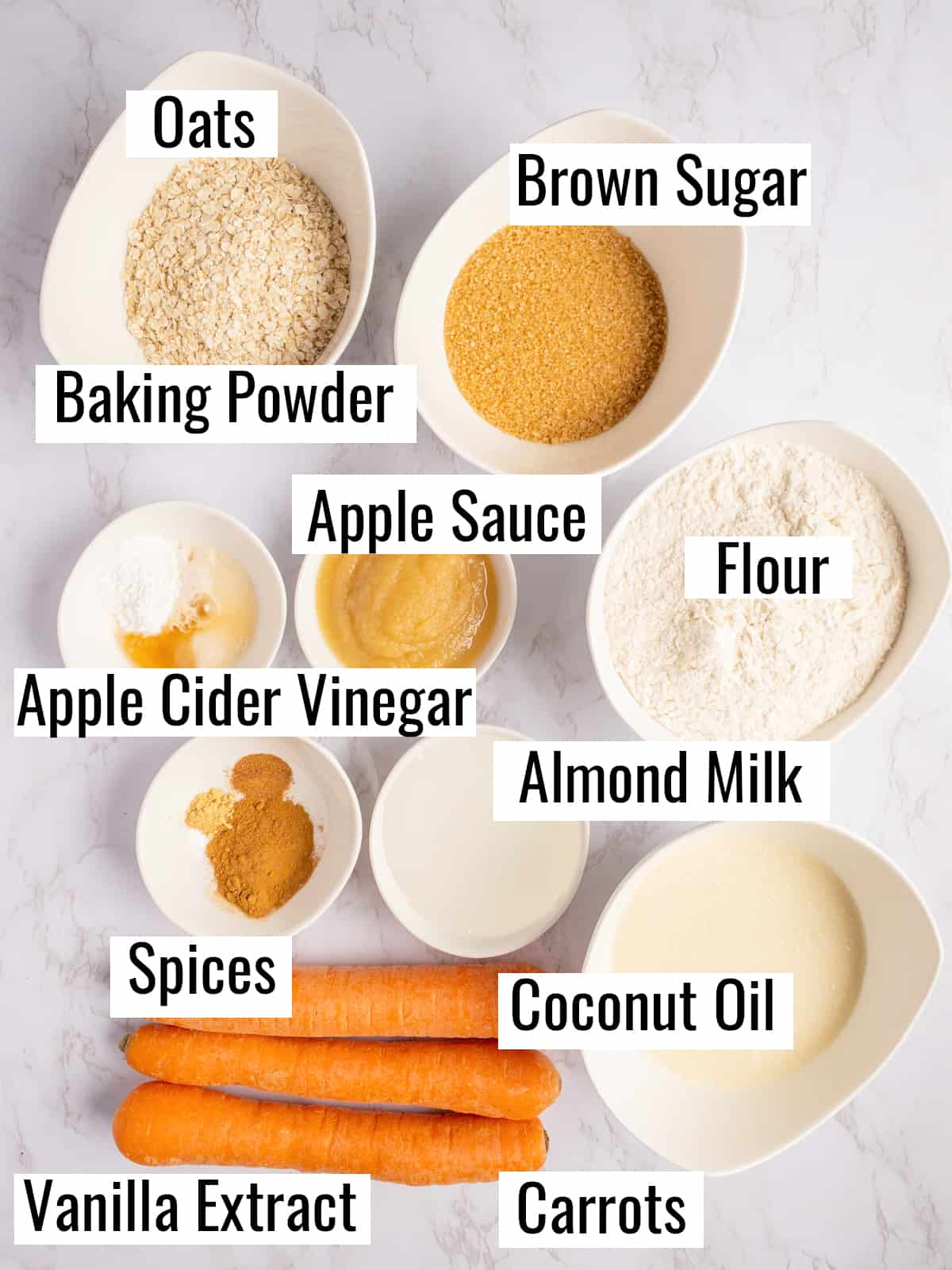 the ingredients that go into this recipe on a marble countertop with labels