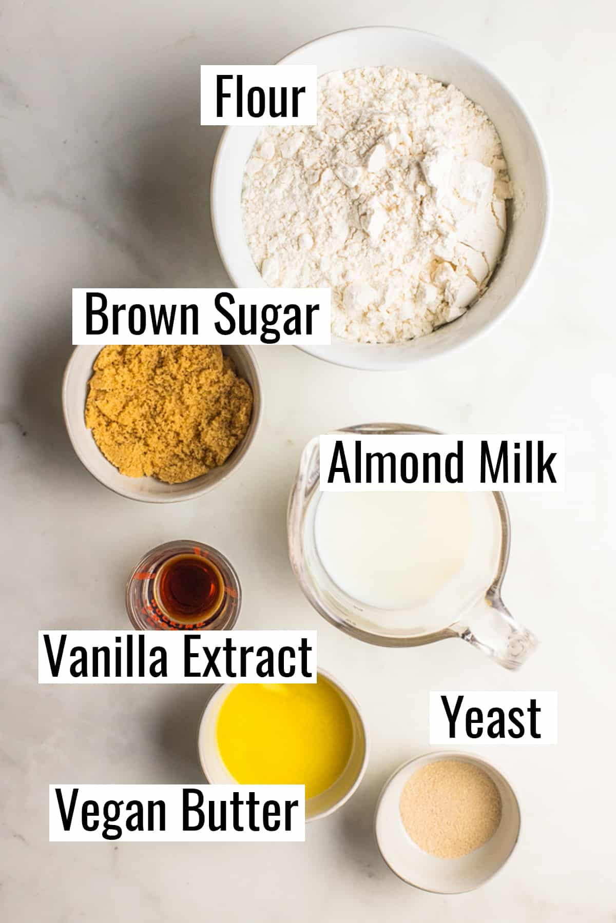 the ingredients that go into this recipe on a concrete countertop with labels